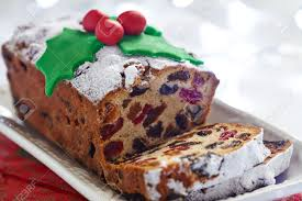 Fruit Decoration For Christmas Cake by Christmas Fruit Cake Decorated With Holly And Berries Stock Photo