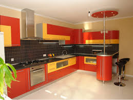 sophisticated modern kitchen with red orange accent color combined