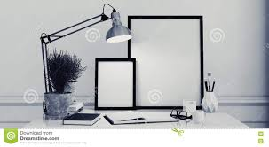 blank picture frames on a simple modern desk stock photo image