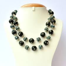 blue beads necklace images Handmade necklace with blue black beads having metal flowers jpg