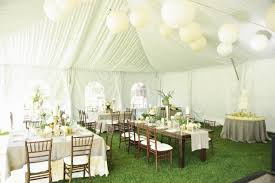 white lantern centerpieces decorate tent for wedding weddings table flowers diy