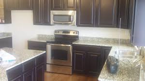 dark cabinets light granite kitchen most popular home design
