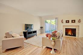 contemporary living room with crown molding hardwood floors in