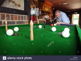 pubga e a man playing a game of billiards an old traditional pub game