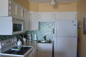 5 refreshing backsplash ideas for bathrooms with blue glass tile decorating ideas gorgeous l shape kitchen decoration with light green beach glass tile backsplash including