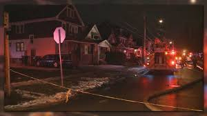 new home sources one woman is dead and one person is in custody after a house fire in