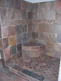 slate tile bathroom ideas a truly custom designed shower using slate tiles and frameless