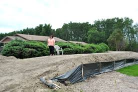 photos mother protects home from flood with 4 000 yard berm panow
