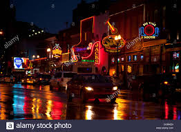 neon bar signs at night on main street in nashville tennessee