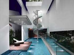 sleek modern home in singapore with glass bridge over pool stylish