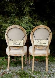 his and hers wedding chairs event decor