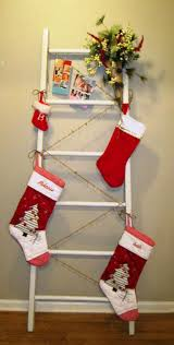 decorating stocking hooks for the mantle with christmas stocking