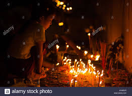 a lights candles during the evening ceremony at the that