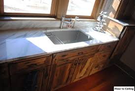 log cabin kitchen remodel features blanco precis cascade sink and