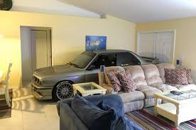 lexus v8 in bmw e30 enthusiast parks his bmw e30 m3 in living room to escape hurricane