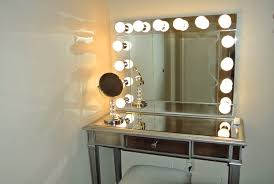 rectangle mirror makeup vanity table with mirror having lights on the corner