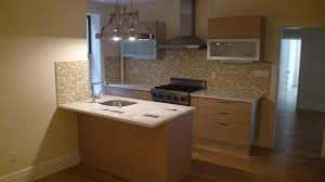L Shaped Apartment by L Shaped White Wooden Kitchen Cabinet With Brown Countertop On