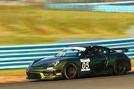 porsche cayman racing luxury car dealer praises porsche in both racing and business