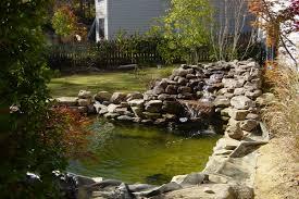 Small Backyard Fish Pond Ideas Two Round Backyard Koi Pond Ideas Mixed With Stone Edge Placement