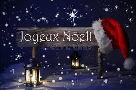 sign candlelight santa hat joyeux noel means merry stock