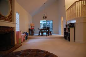 Living Rooms Without Sofas Lisa Moves Small Cozy Space Vs The Cavernous Room With No Furniture