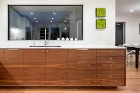 grain matched walnut cabinets white countertops with chrome