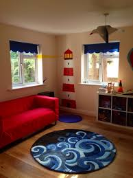 Bedroom Design Considerations Playroom Decor With Carpet And Red Sofa On Wood Floored Room