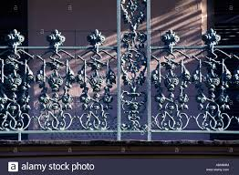 detail of intricate wrought iron balcony railing in the french