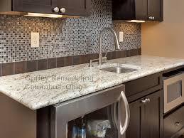 colonial cream granite kitchen contemporary with dark cabinets