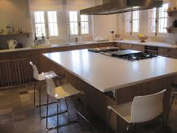 would you okay with just having kitchen island and dining dinner parties will resemble ppl sitting the sushi bar while you and one other person cook entertain for them