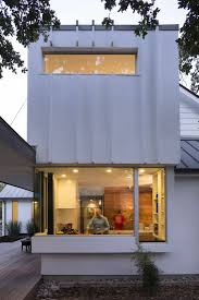 textured front facade modern box home the architect is in the family cottage reinvented austin edition