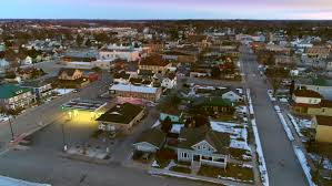 small town america aerial flyover of peaceful small town america at twilight stock