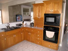 oak kitchen cabinets with black hardware kitchen