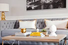 gray tufted sofa with gold lamps transitional living room