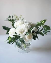 White Roses In A Vase I Each Restroom There Will Be A Skinny Cylinder Vase With White