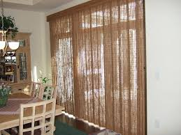 Drapes On Sliding Glass Doors by Kitchen Interior Sliding Glass Door With Long Blue Curtains On