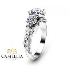 sapphire studios black moissanite white three stone moissanite engagement ring 14k white gold moissanite