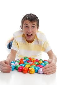 casual easter excited boy in casual clothing with lots of easter eggs stock