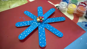 diy snowflakes using popsicle stick ornaments christmas crafts