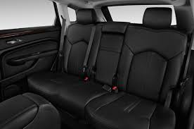 cadillac jeep interior comparison cadillac srx premium 2015 vs jeep cherokee 2017