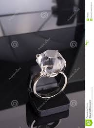 black box rings images Giant engagement ring too big for ring case black background jpg