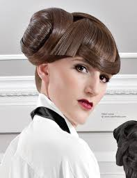 updo with a sweet roll bun on the side of the head