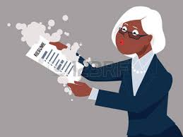 senior woman dusting off her resume returning to work esp 8