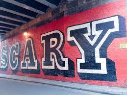 london street art alphacityguides ben eine scary mural in london