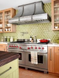 red kitchen tile backsplash wall mount pot filler faucets flower pattern green tile backsplash