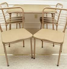Cosco Folding Table And Chairs Vintage 1950s Cosco Folding Gaming Table And Four Chairs Ebth