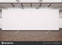 large blank wall in an art gallery with dark wood floor u2014 stock