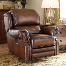 living room design with brown leather rocker recliner swivel chair
