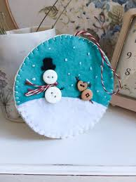 a handmade cottage felt christmas decorations with the cottage