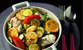 cuisiner la lotte au four recette de lotte au plat aux tomates et aux courgettes